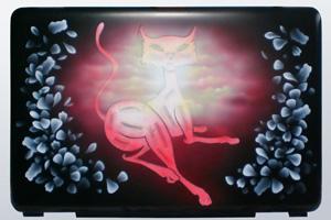 Кошка на ноутбуке